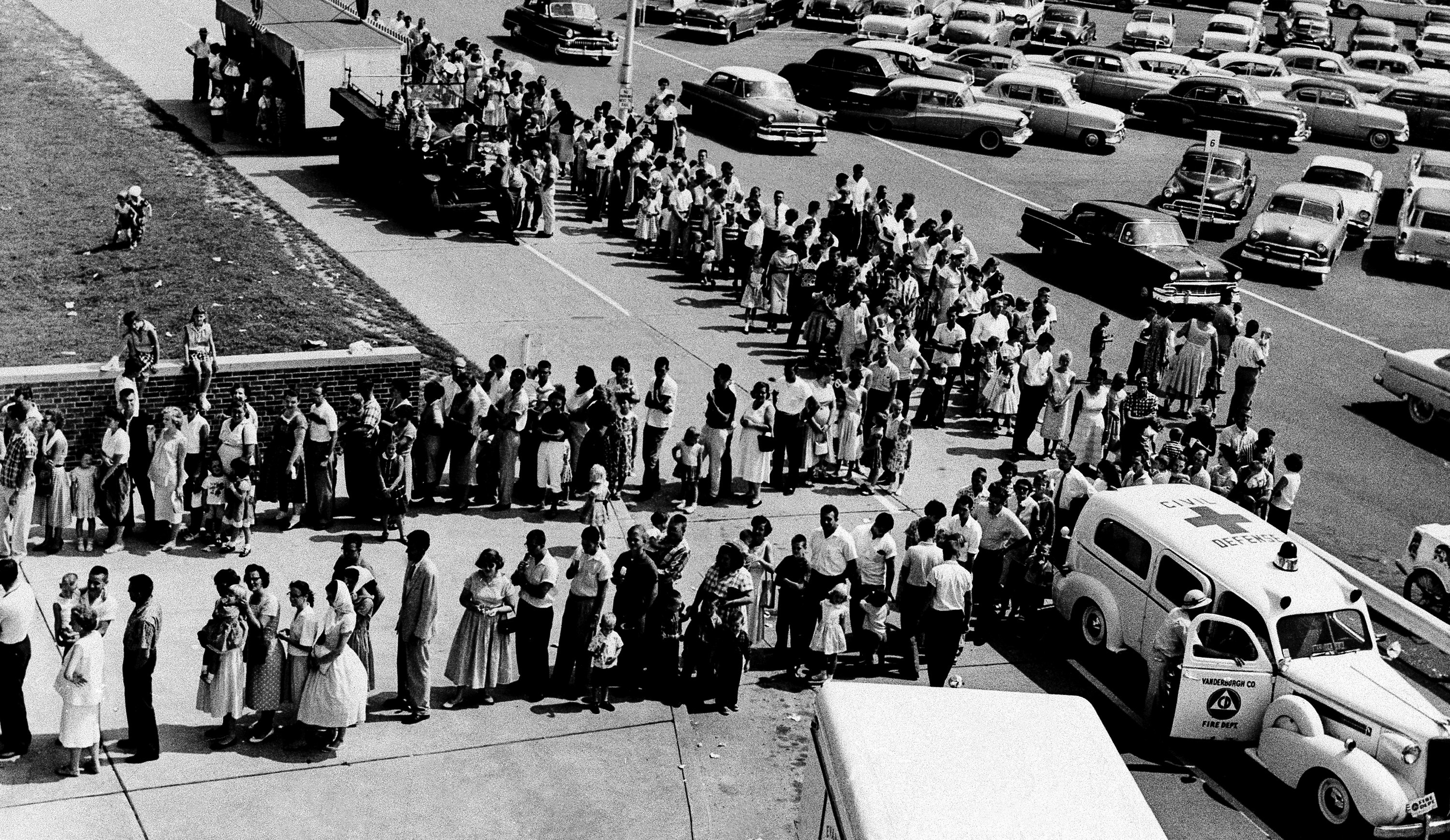 People waiting for a polio shot.