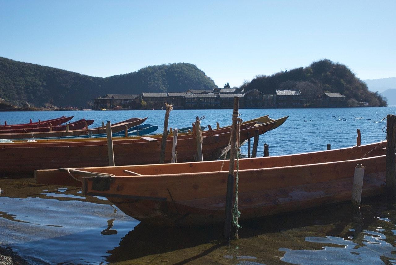 Mosuo boats on scenic Lugu Lake.